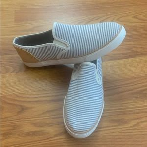 Blue and white striped slip ons